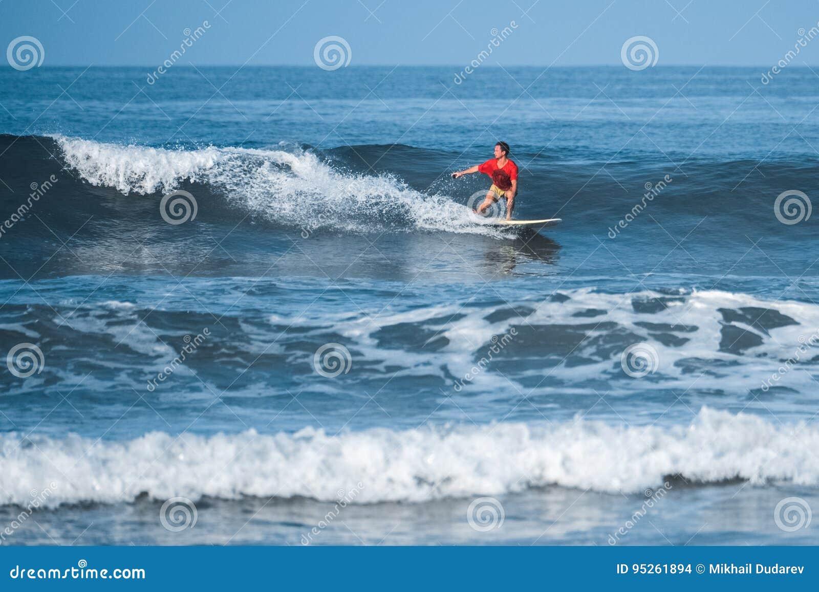 Amateur surfer rides the wave