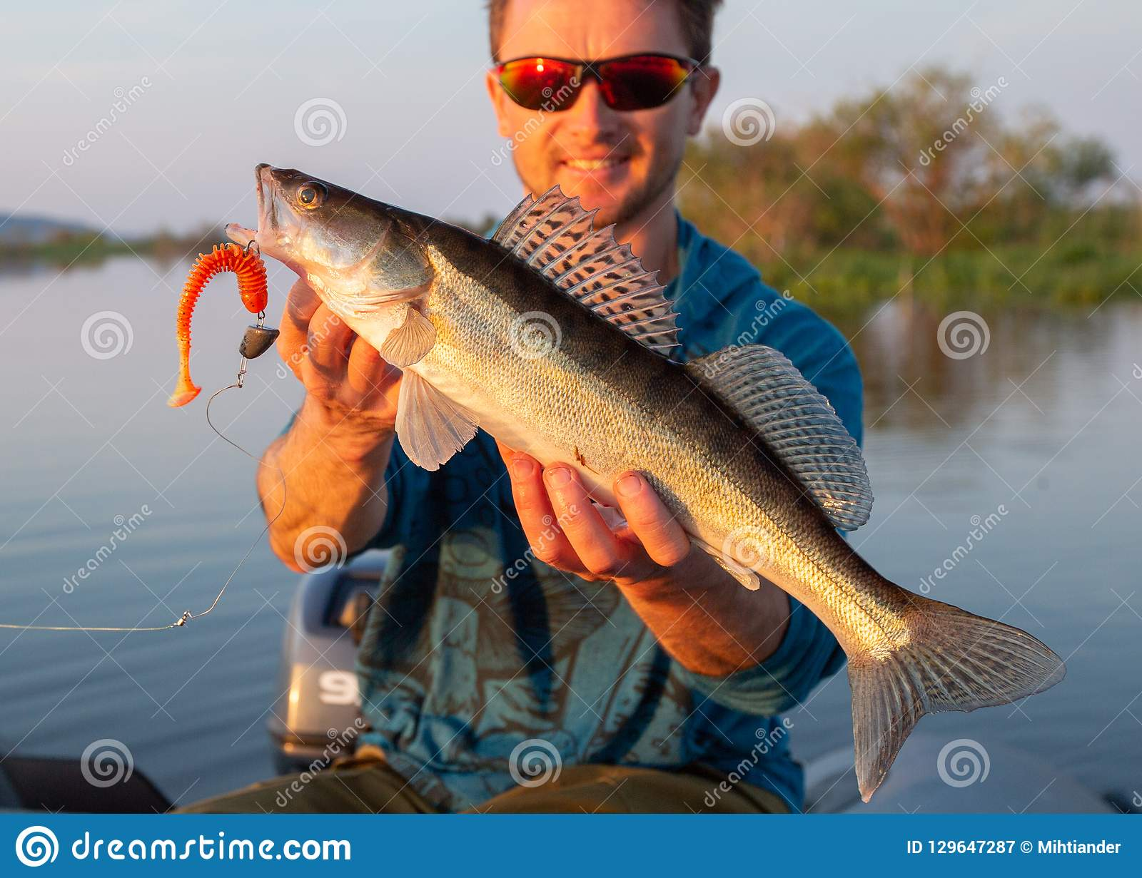 Amatuer angler holds fish