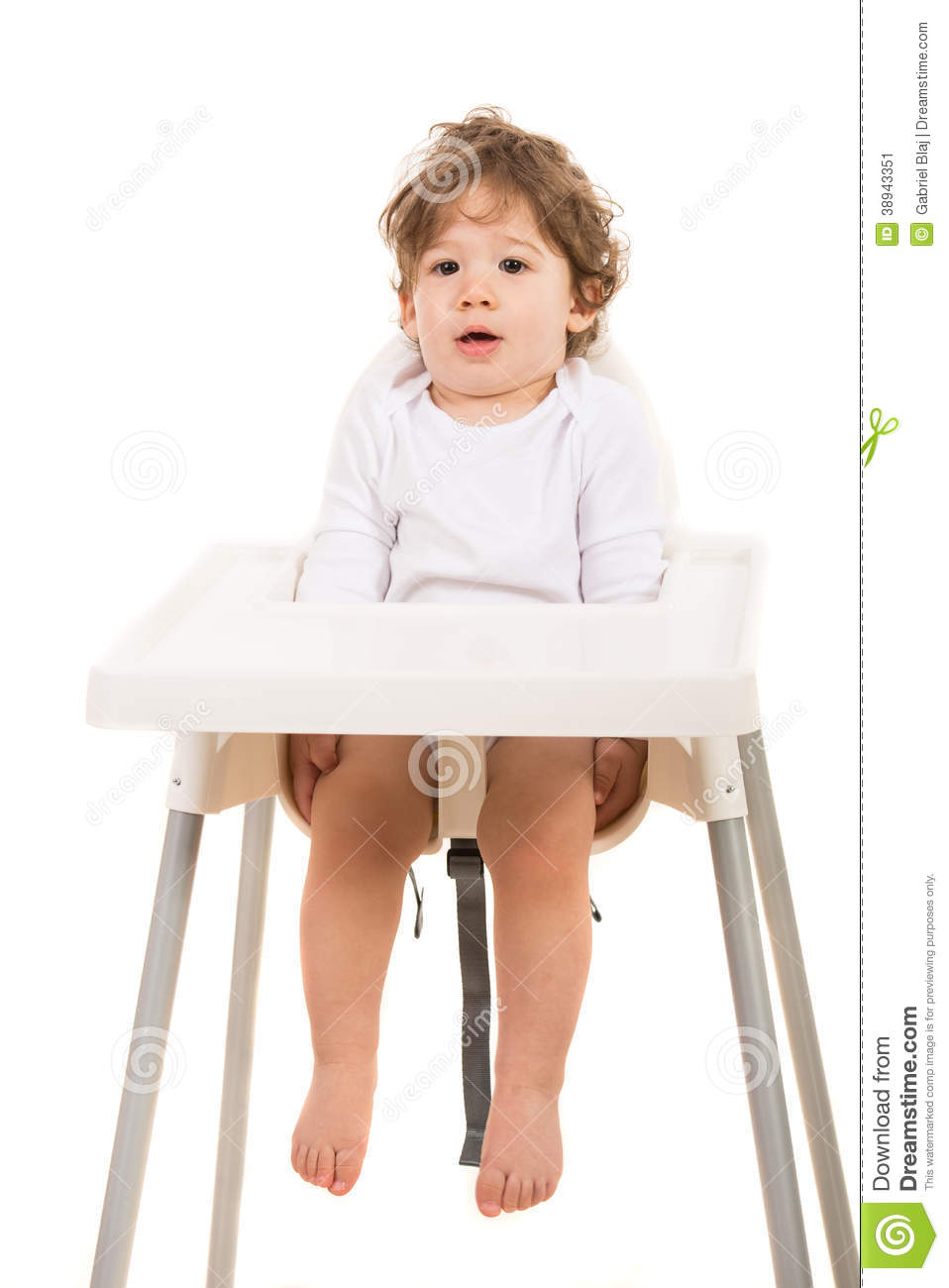 Amazed boy standing straight in chair stock photo image for White toddler chair