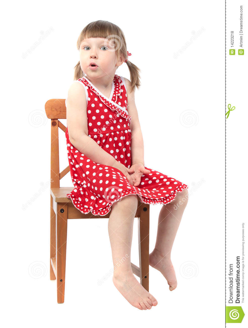 Amazed child sitting on a chair royalty free stock photos for Toddler sitting chair