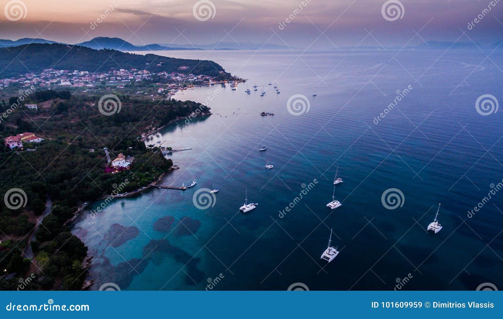 Amazing aerial shot of sunset coastline at South Corfu Greece.