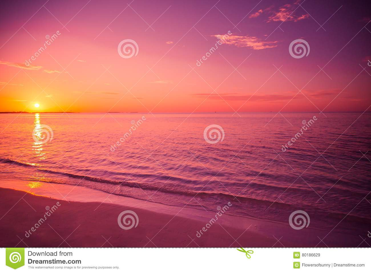 Amazing beach sunset. Relaxing colors with soft waves