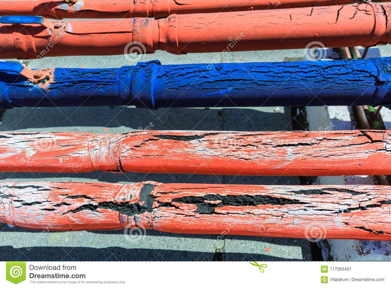 Amazing detailed closeup view of old cracked rubber covered communication pipes, abstract