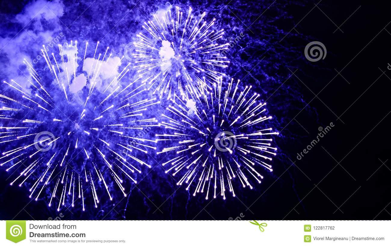 Amazing fireworks flowers on the night sky. Brightly blue fireworks on dark black color background. Holiday relax time with