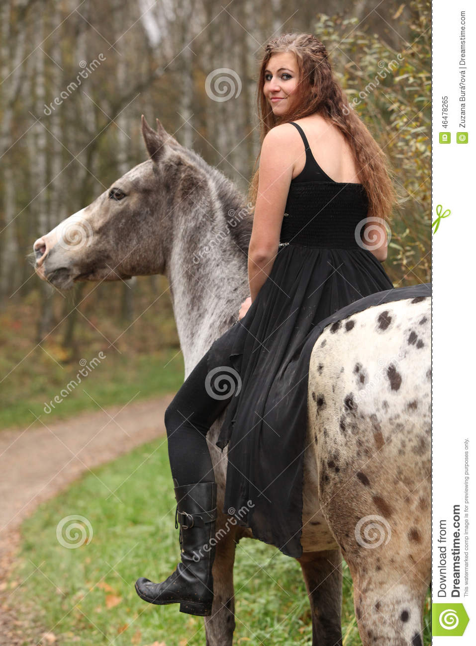 Amazing Girl With Long Hair Riding A Horse Stock Image