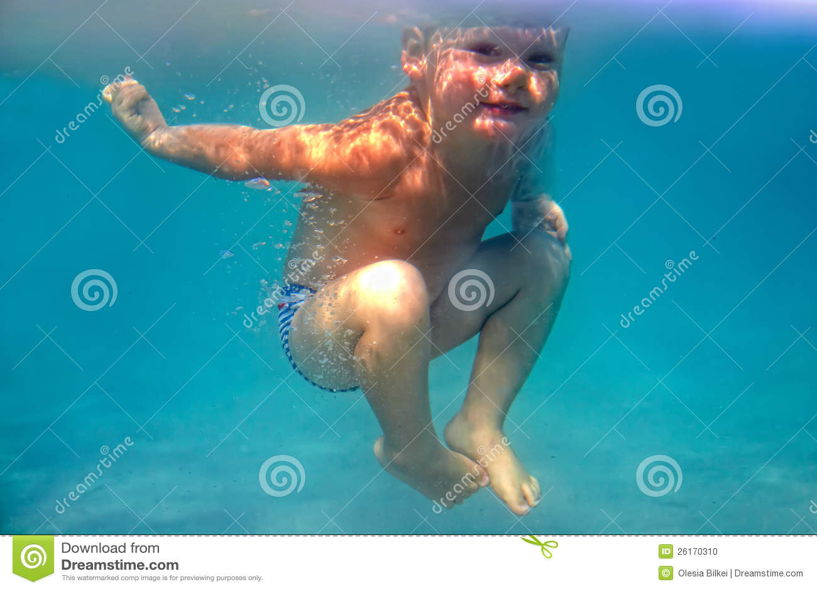 Amazing happy baby boy dives underwater