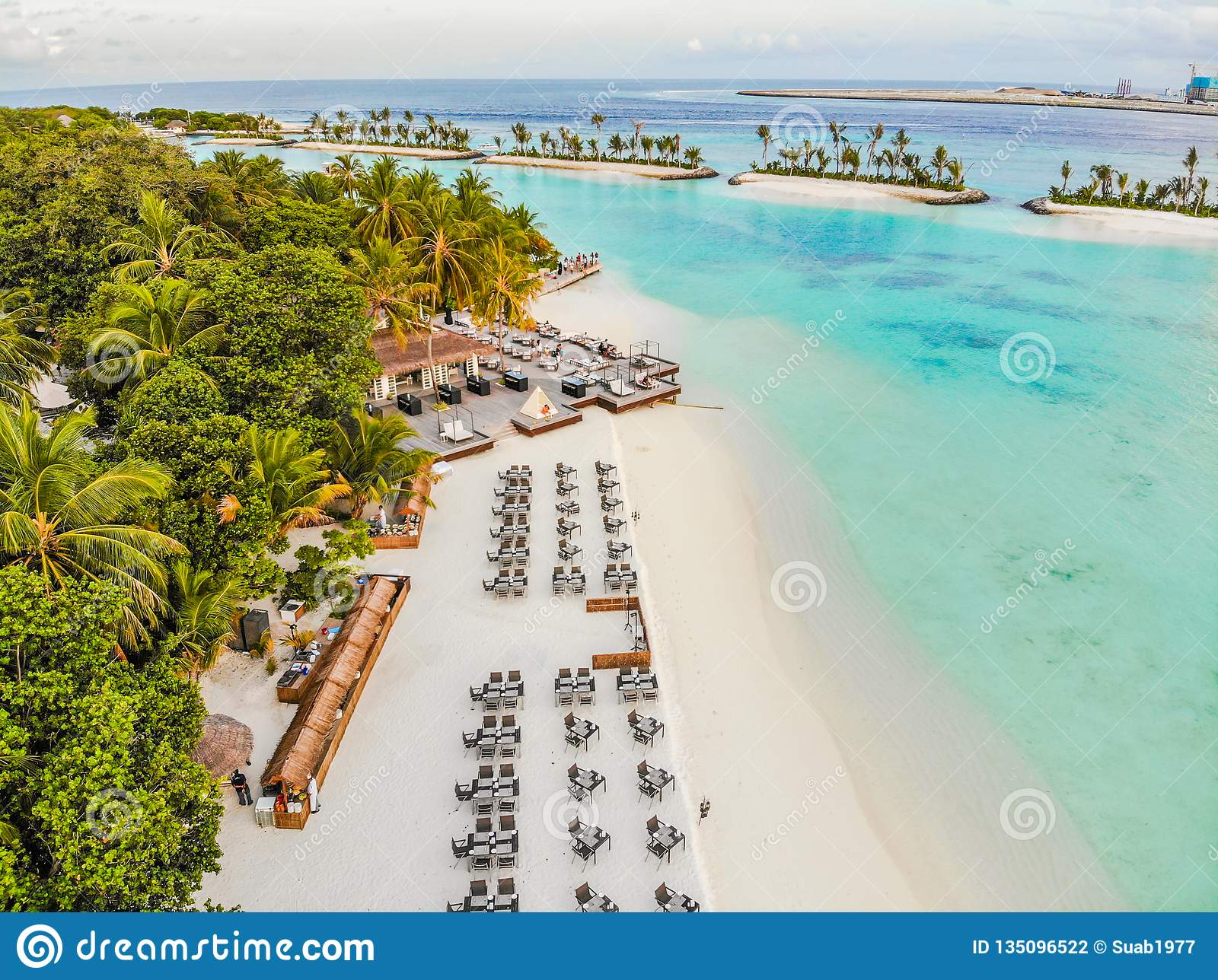 Amazing island in the Maldives ,Beautiful turquoise waters and white sandy beach with blue sky background