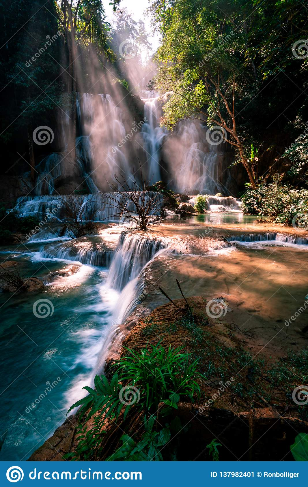 Amazing Kuang Si Falls in Luang Prabang, Laos. Perfect blue water combined with beautiful sunlight and powerful green colors.