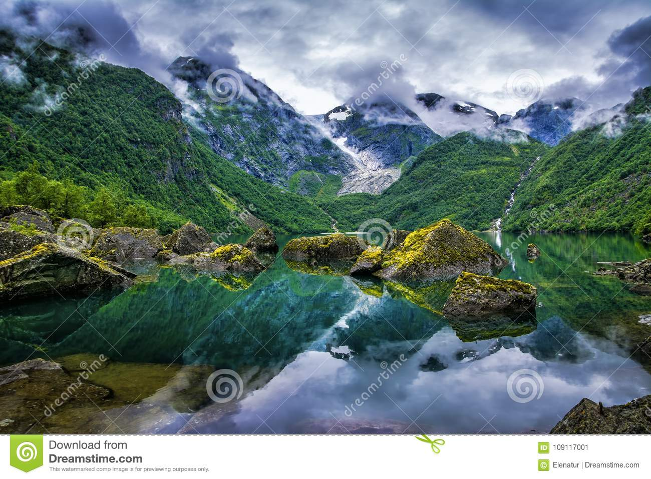 Amazing lake on a background of mountains and glacier. Norway. B