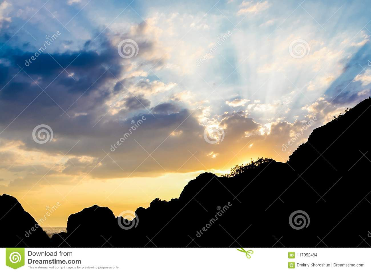 Amazing landscape of Mountain Sunset. Beautiful rays of the Sun against the Sky with colorful clouds.