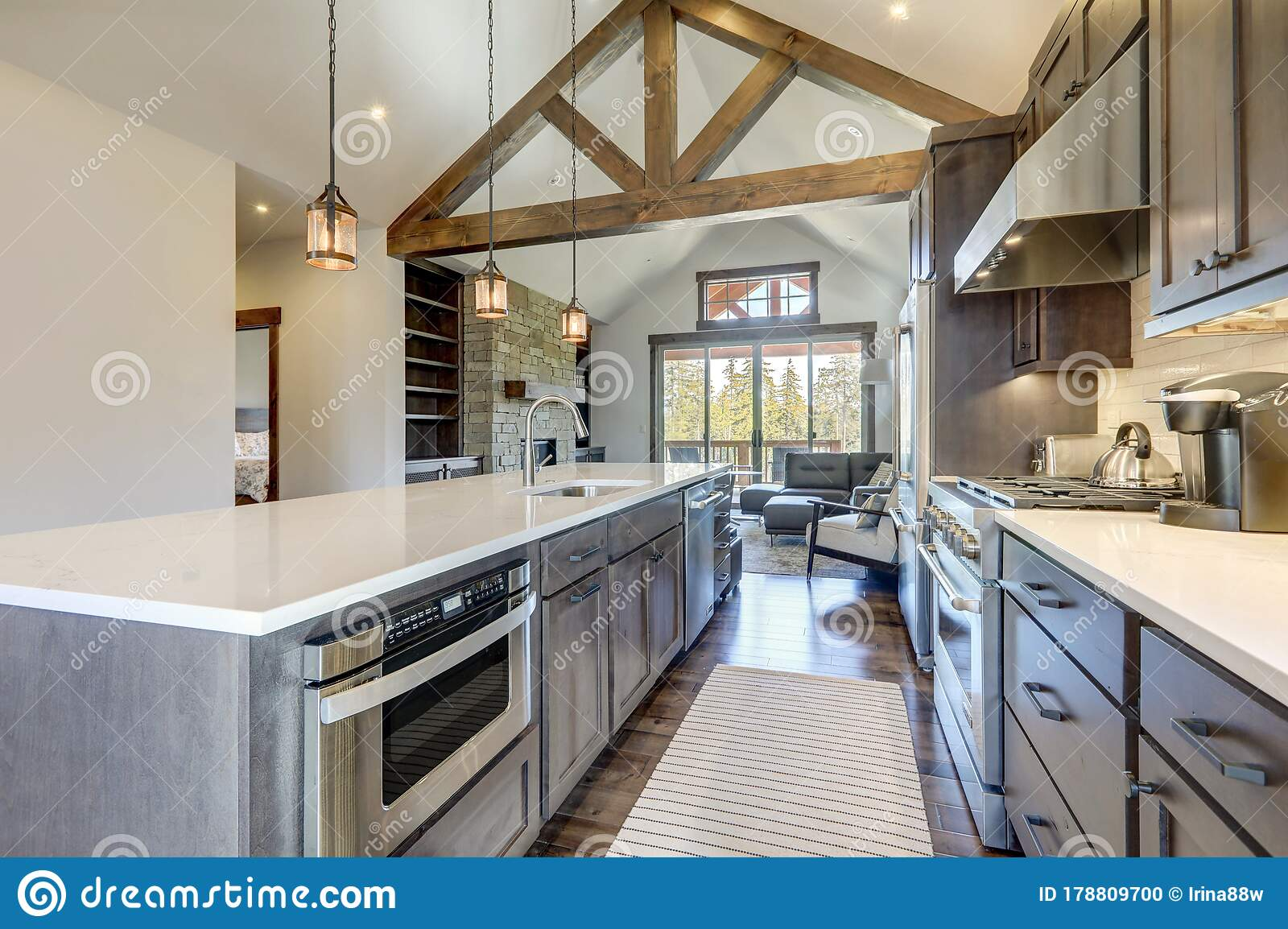 Image of: Amazing Modern And Rustic Luxury Kitchen With Vaulted Ceiling And Wooden Beams Long Island With White Quarts Countertop Stock Photo Image Of Colorful Furnished 178809700