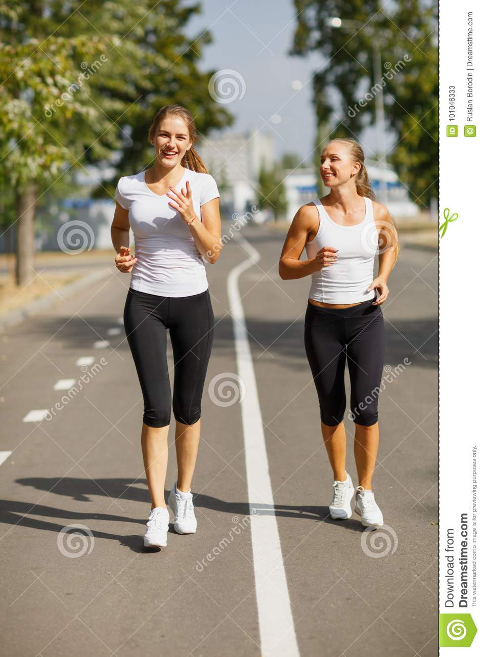 Gorgeous Girls Running On The Blurred