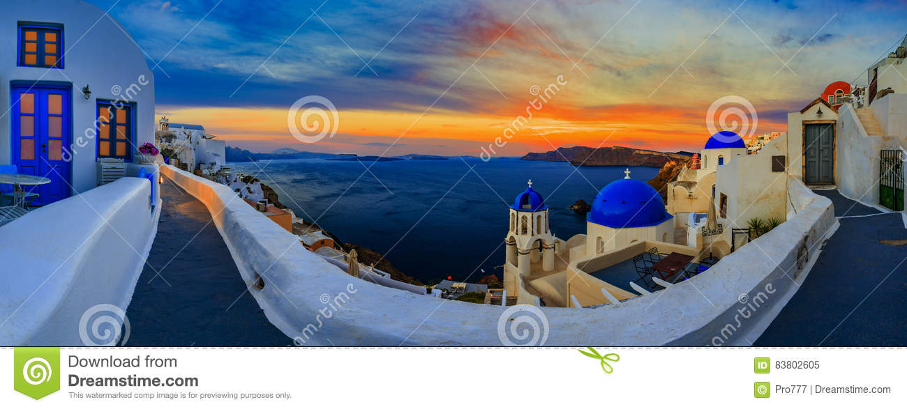 Amazing panorama sunset view with white houses in Oia village on