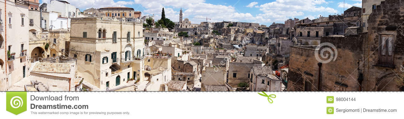 Amazing panoramic view from a balcony of typical stones Sassi di Matera and church of Matera UNESCO European Capital of Culture