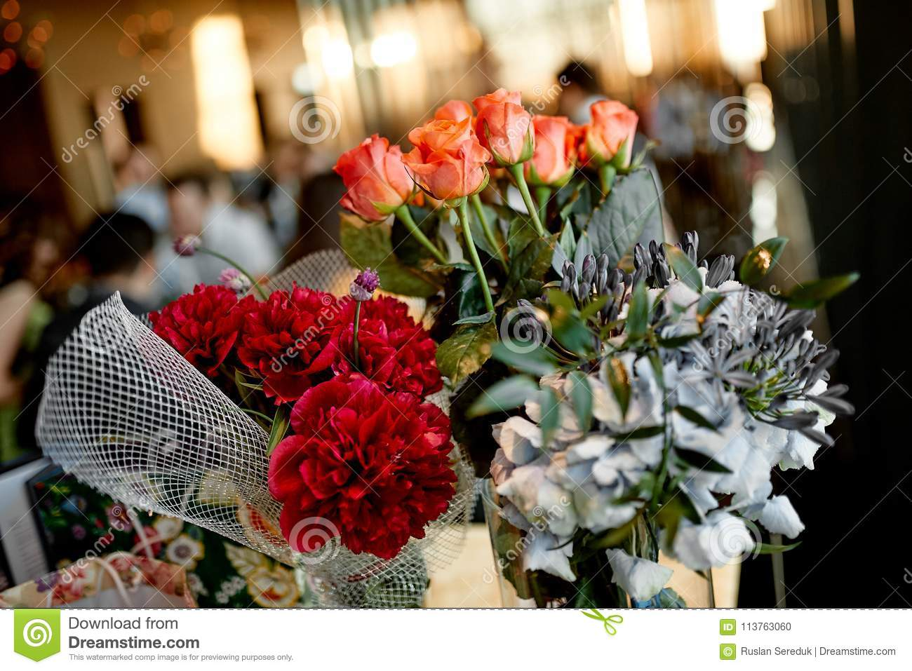 Flowers bouquets on the blur background stock photo image of blue amazing photo of mixed flowers bouquets on the blur background izmirmasajfo