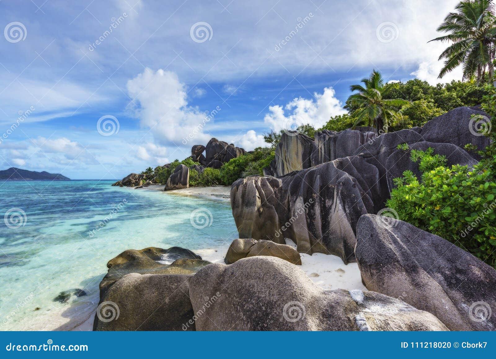 Rocks,white sand,palms,turquoise water at tropical beach,la diqu