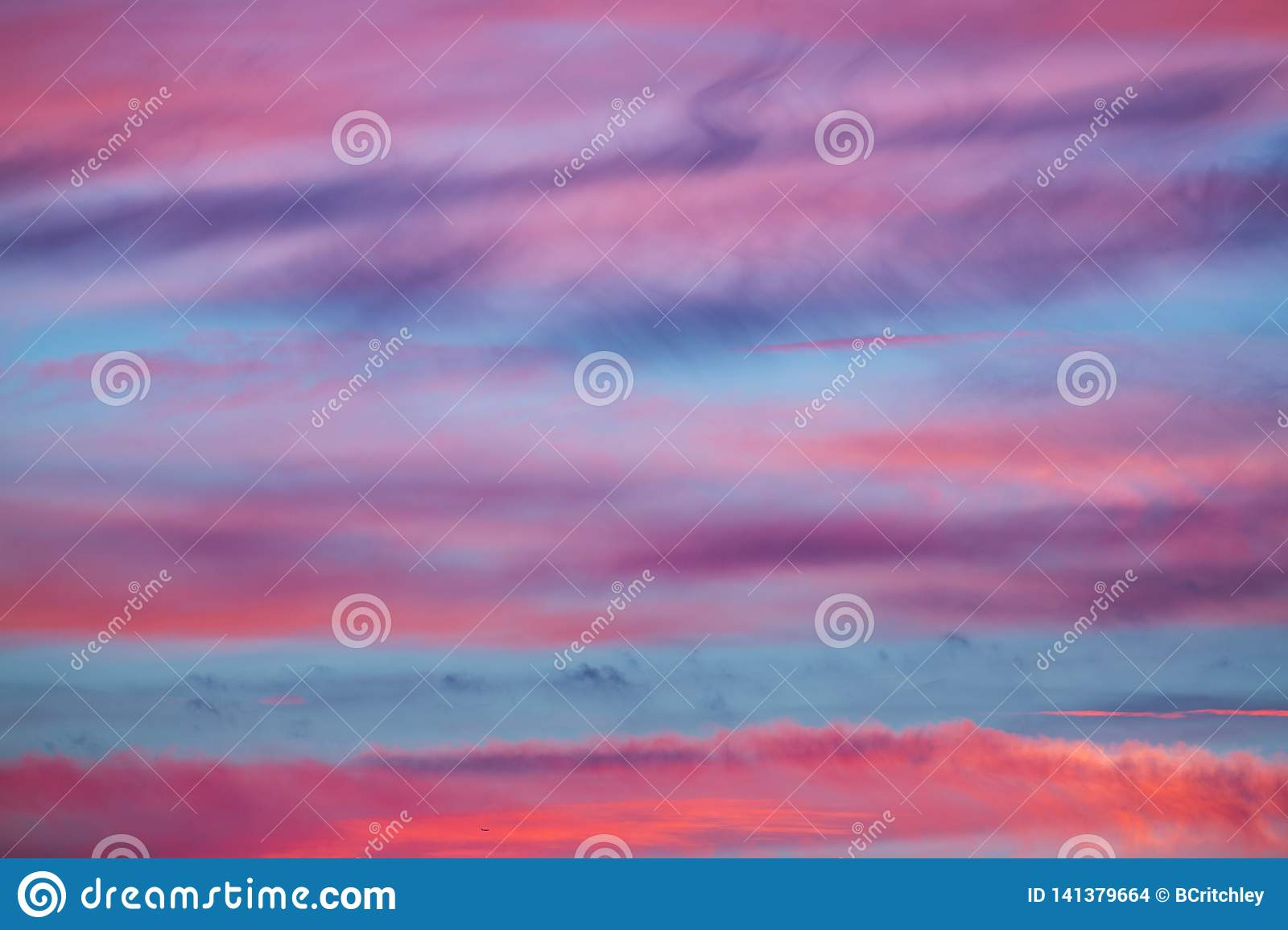 Amazing pink blue abstract sunset sky background