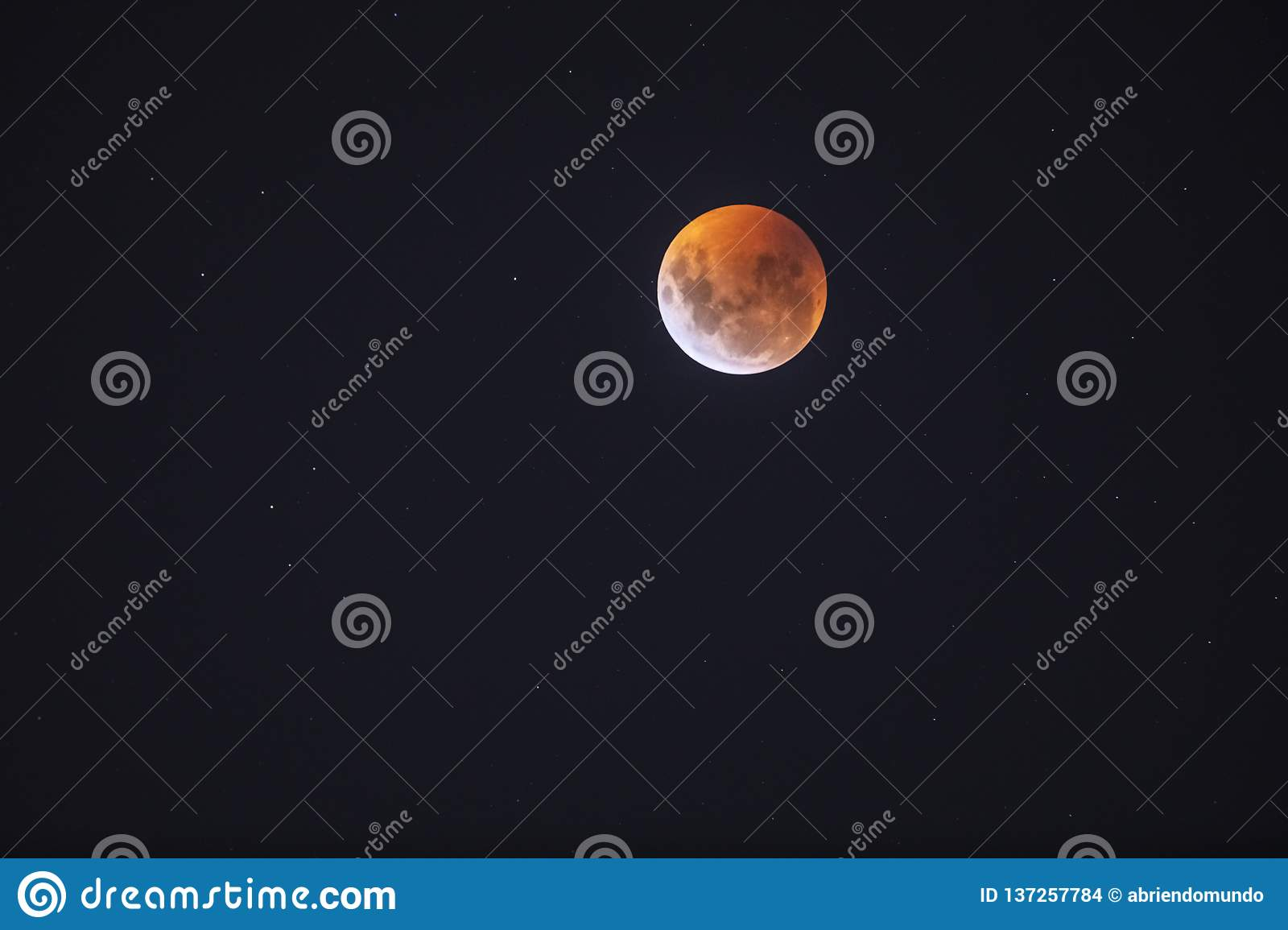 Red full Moon eclipse from Santiago de Chile city, a view from the southern hemisphere of this amazing astronomical event of the E