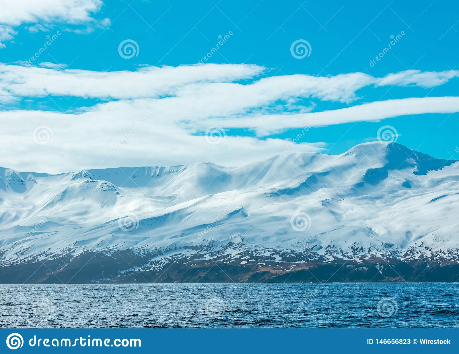 Amazing shot of snowy mountains and the sea
