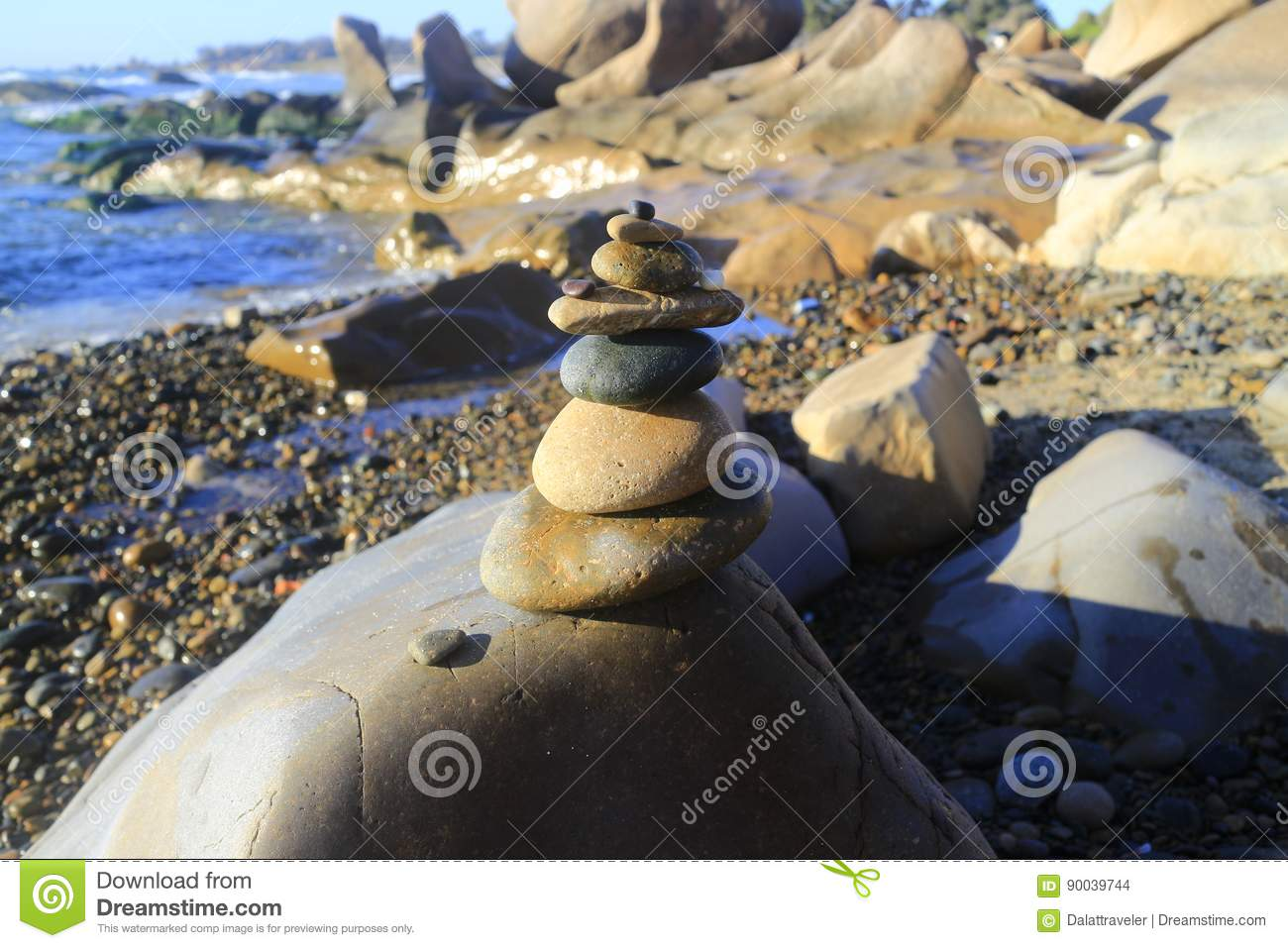Amazing stack of stones on green moss at seaside beach group of pebble balance on large rock