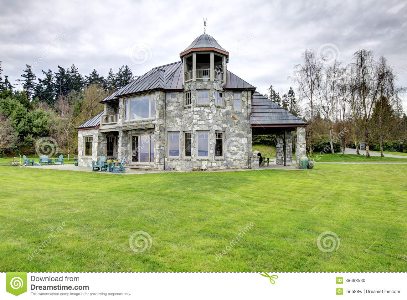 Amazing stone house with a big column porch stock photo for Big amazing houses