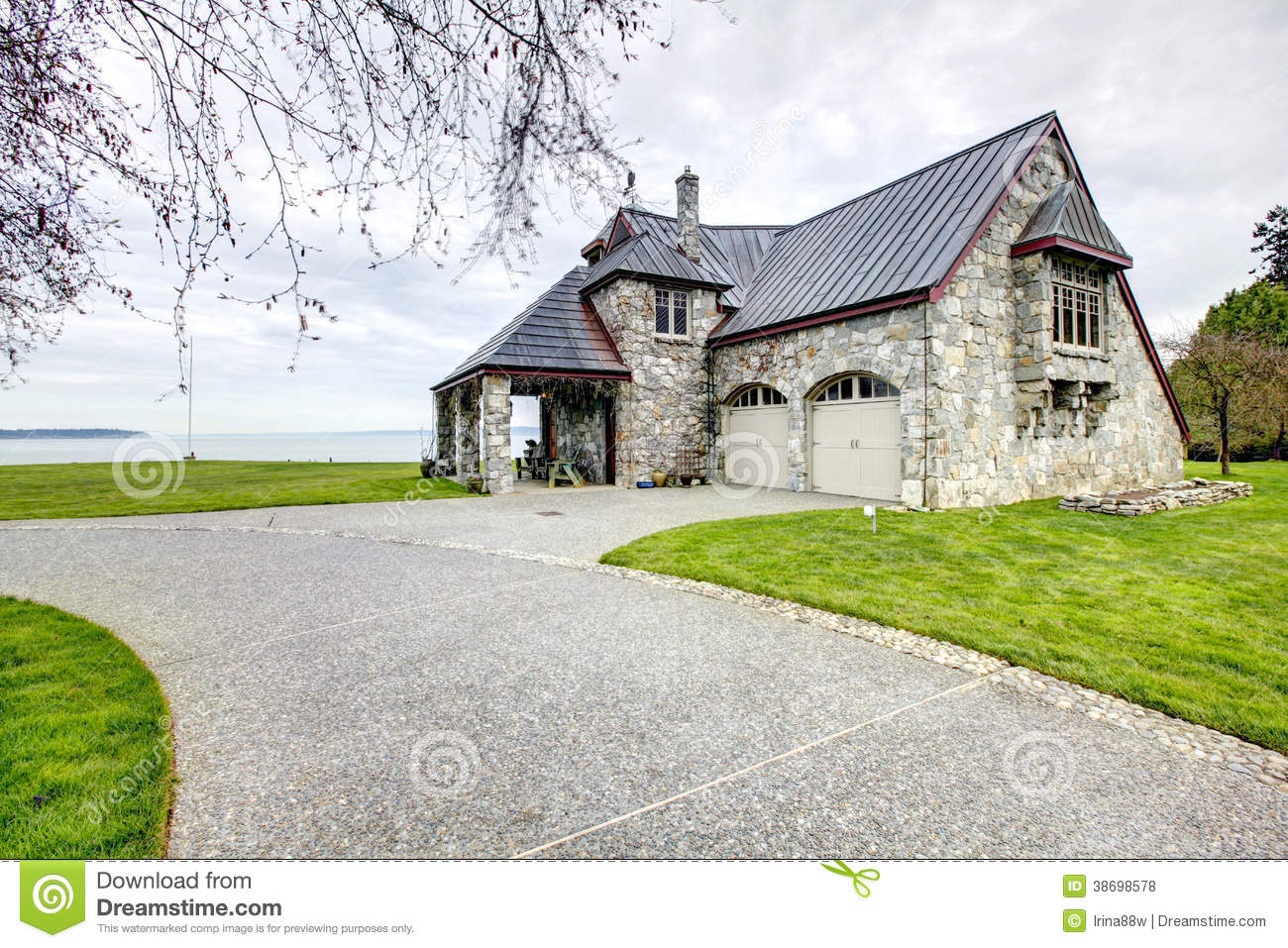 Amazing stone house with column porch and garage stock for Porch garage