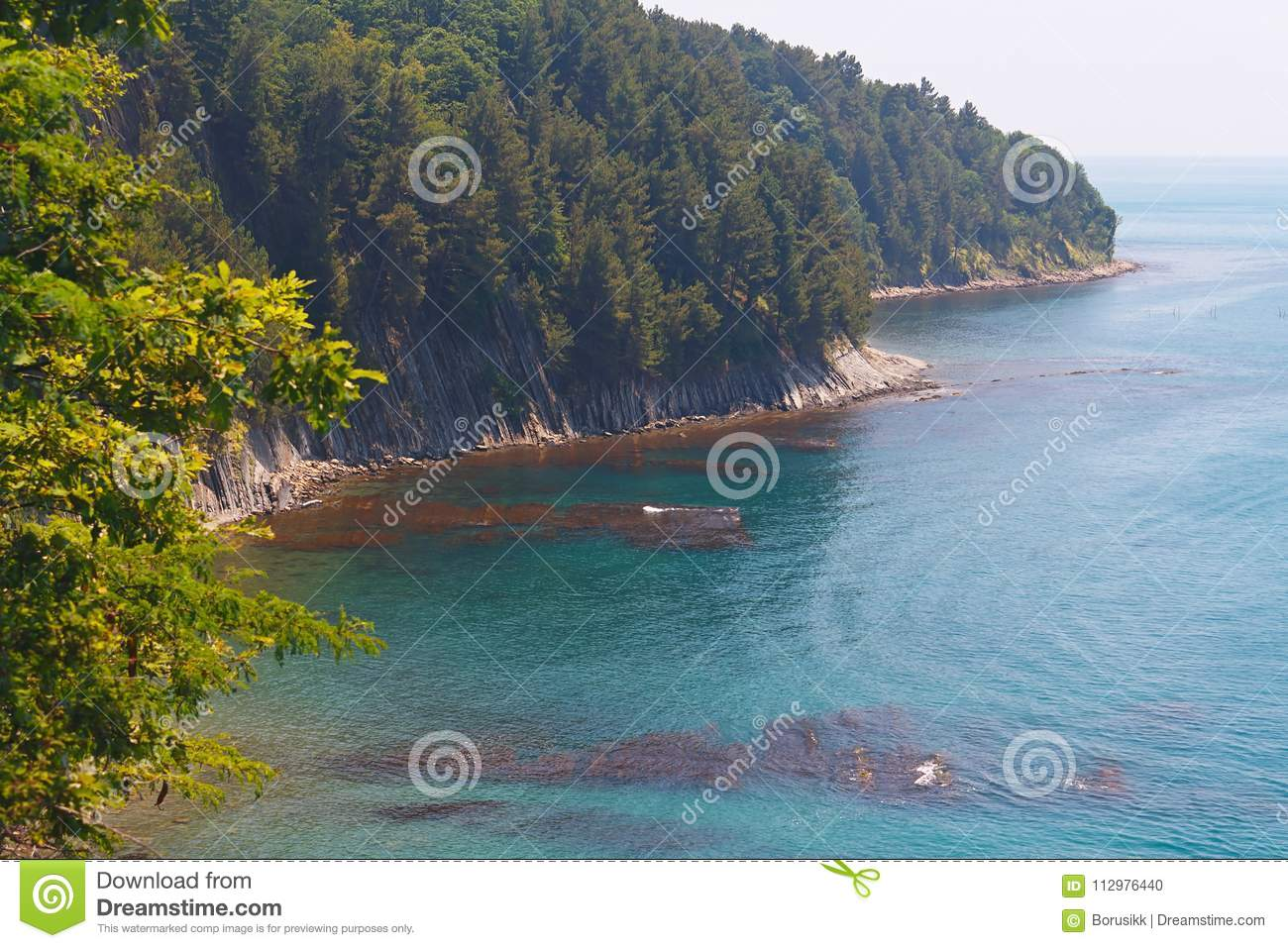 Amazing view from the high coast to sea and the beach with coastal reefs