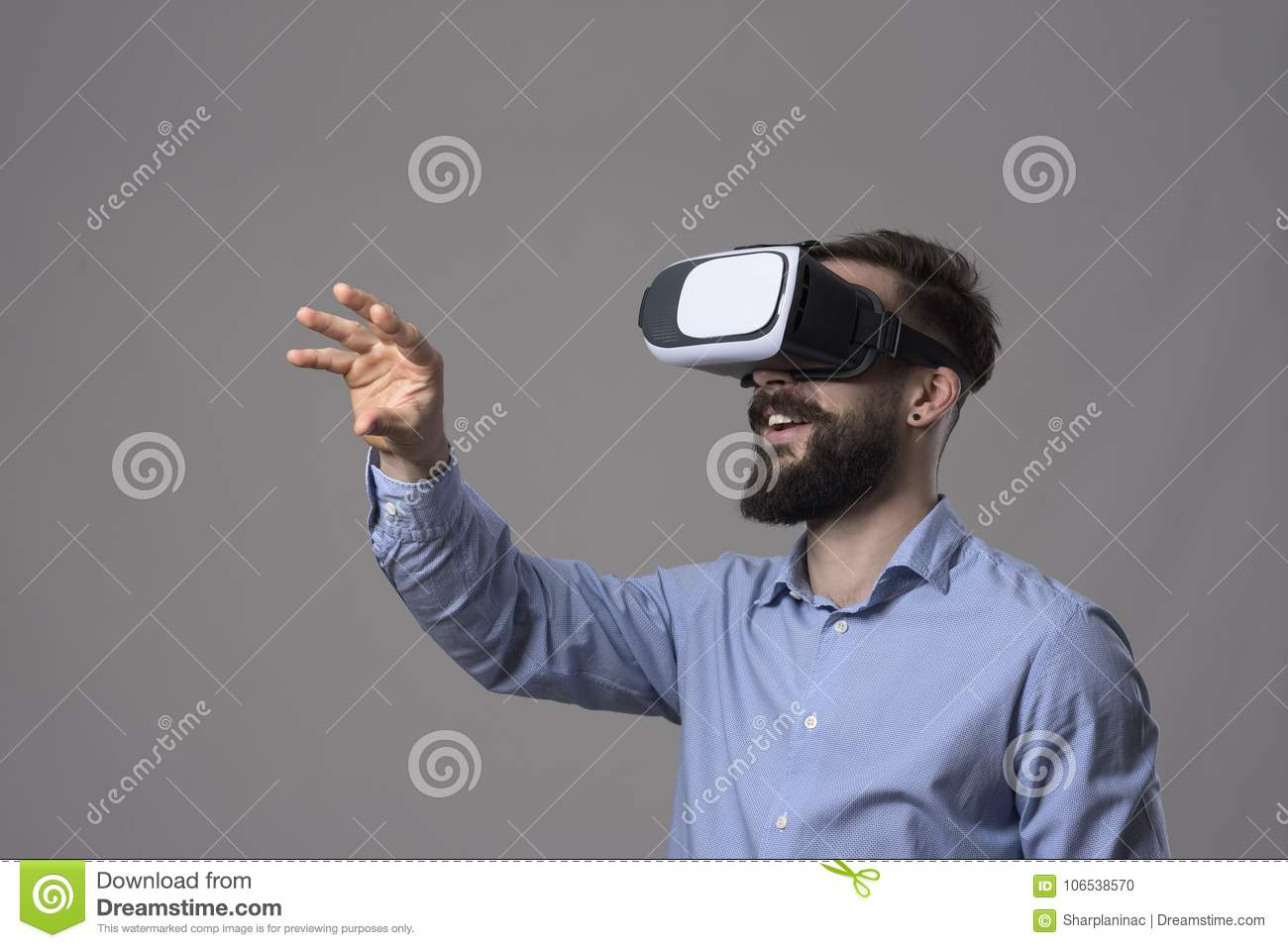 1b700e8d20c4 Amazing virtual reality experience of young business man wearing vr glasses  and gesturing screen by hand over gray studio background with copyspace
