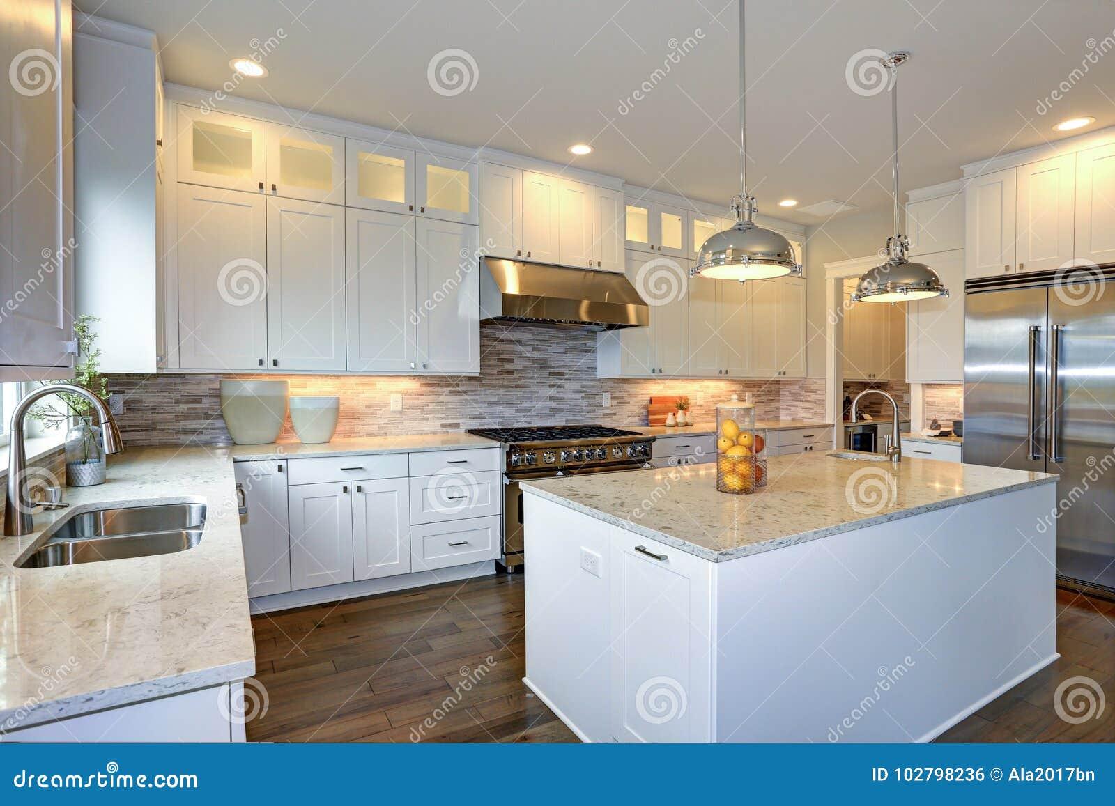 Luxury White Kitchen With Large Kitchen Island. Stock Photo ...