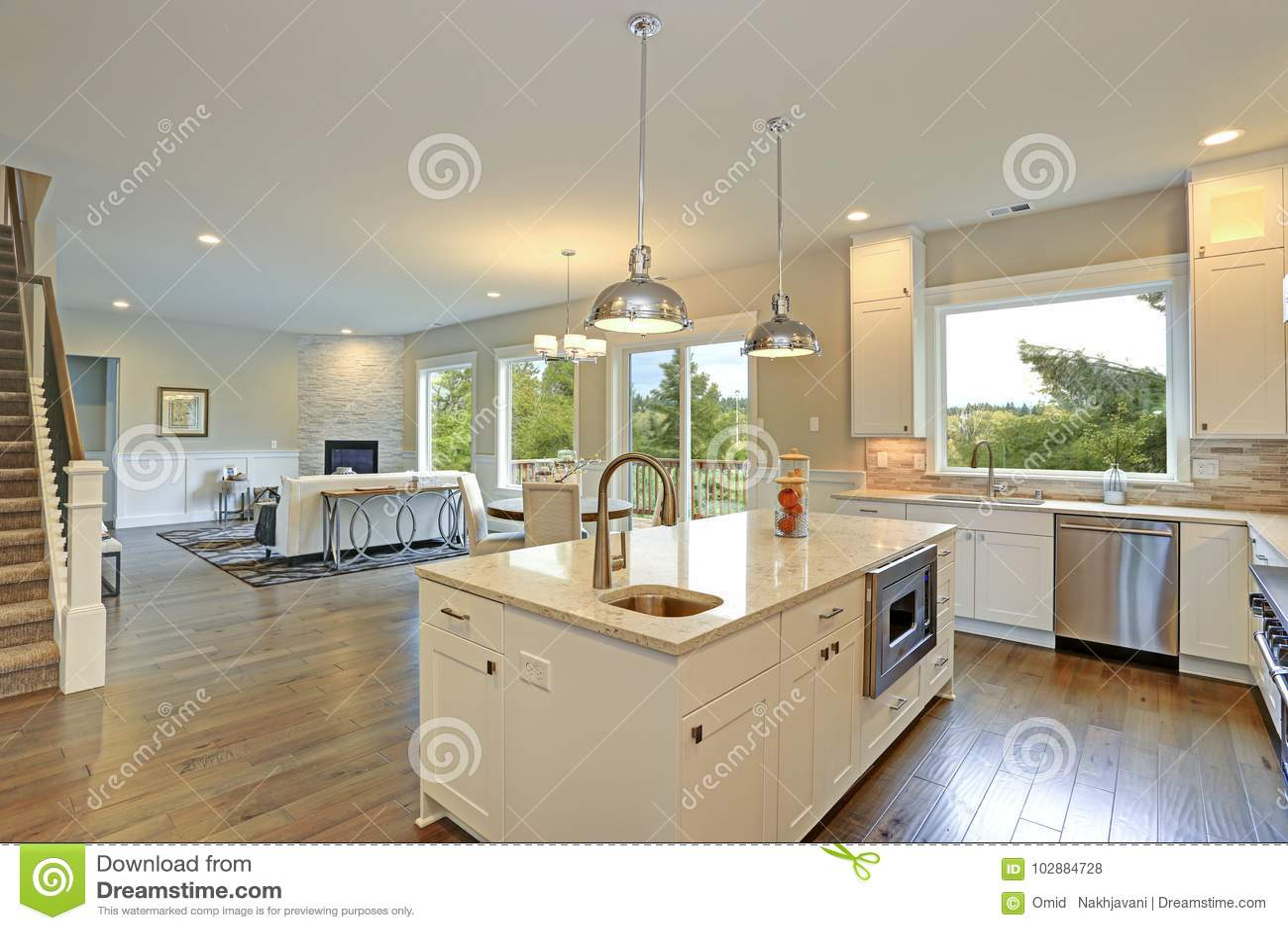 Luxury White Kitchen With Large Kitchen Island. Stock