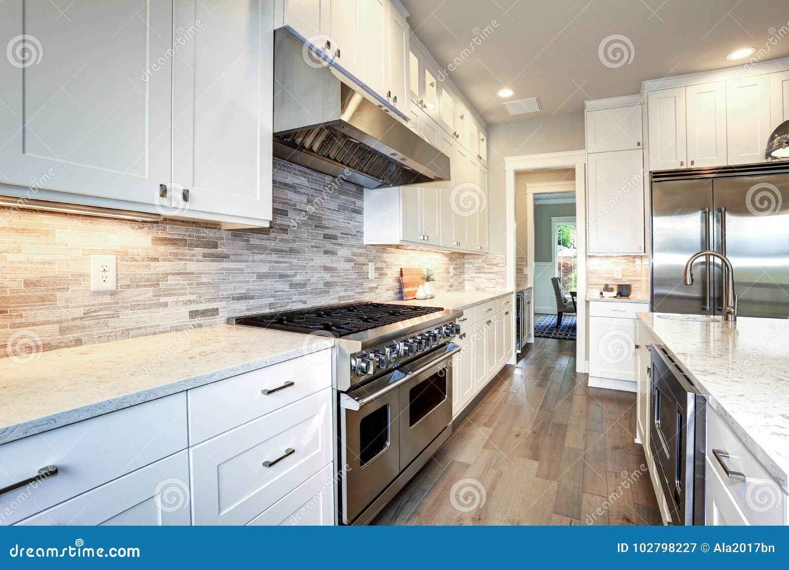 Luxury White Kitchen With Large Kitchen Island Stock Image Image