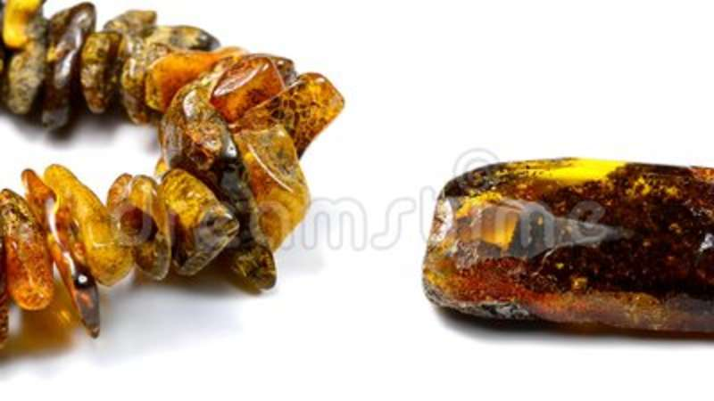 Amber, necklace, bracelet and stones. With camera drive stock footage