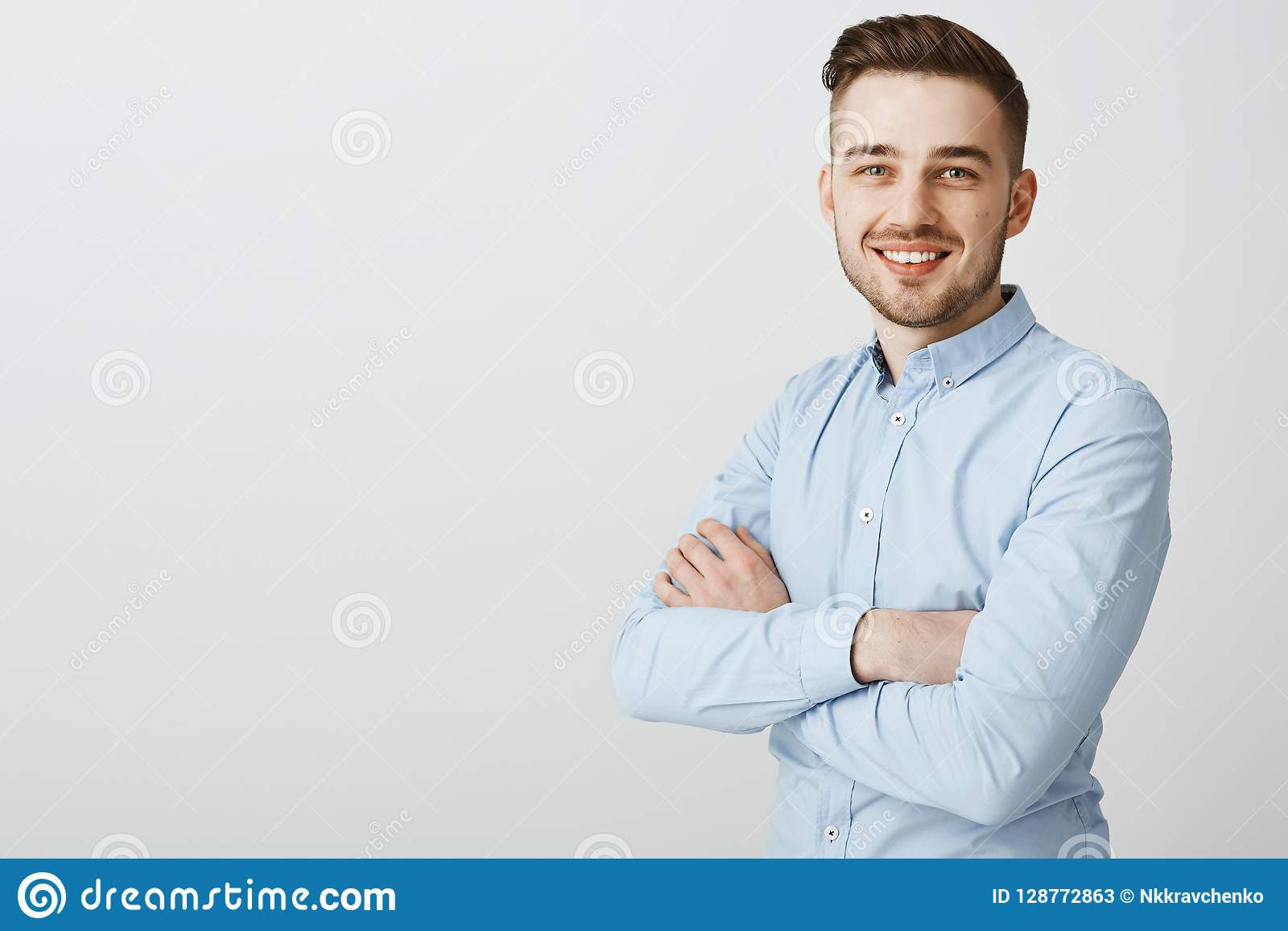 21b0c12edb6 Ambitious smart and creative handsome young male with bristle and stylish  hairstyle in blue collar shirt
