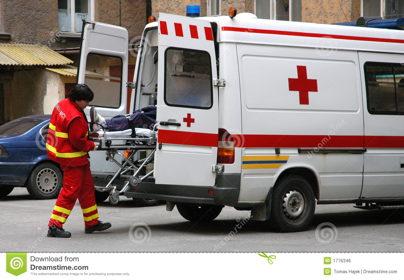 rescue with patient on special litter in ambulance car