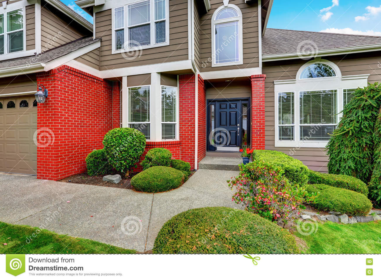 Red Brick House With White Trim Stock Photo
