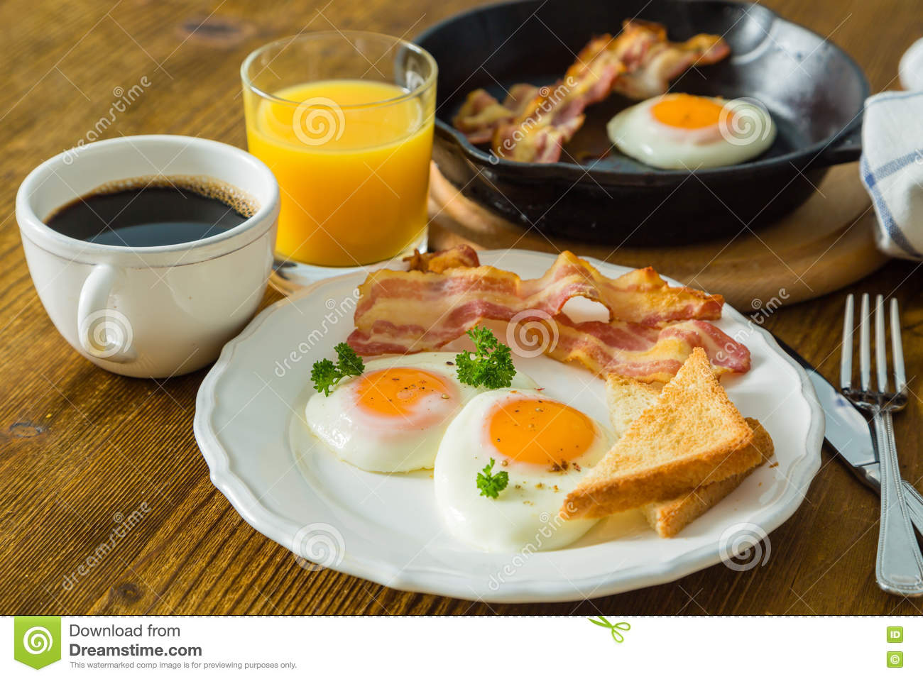 Download American Breakfast With Sunny Side Up Eggs, Bacon, Toast, Pancakes, Coffee And Juice Stock Image - Image of juice, full: 81973499