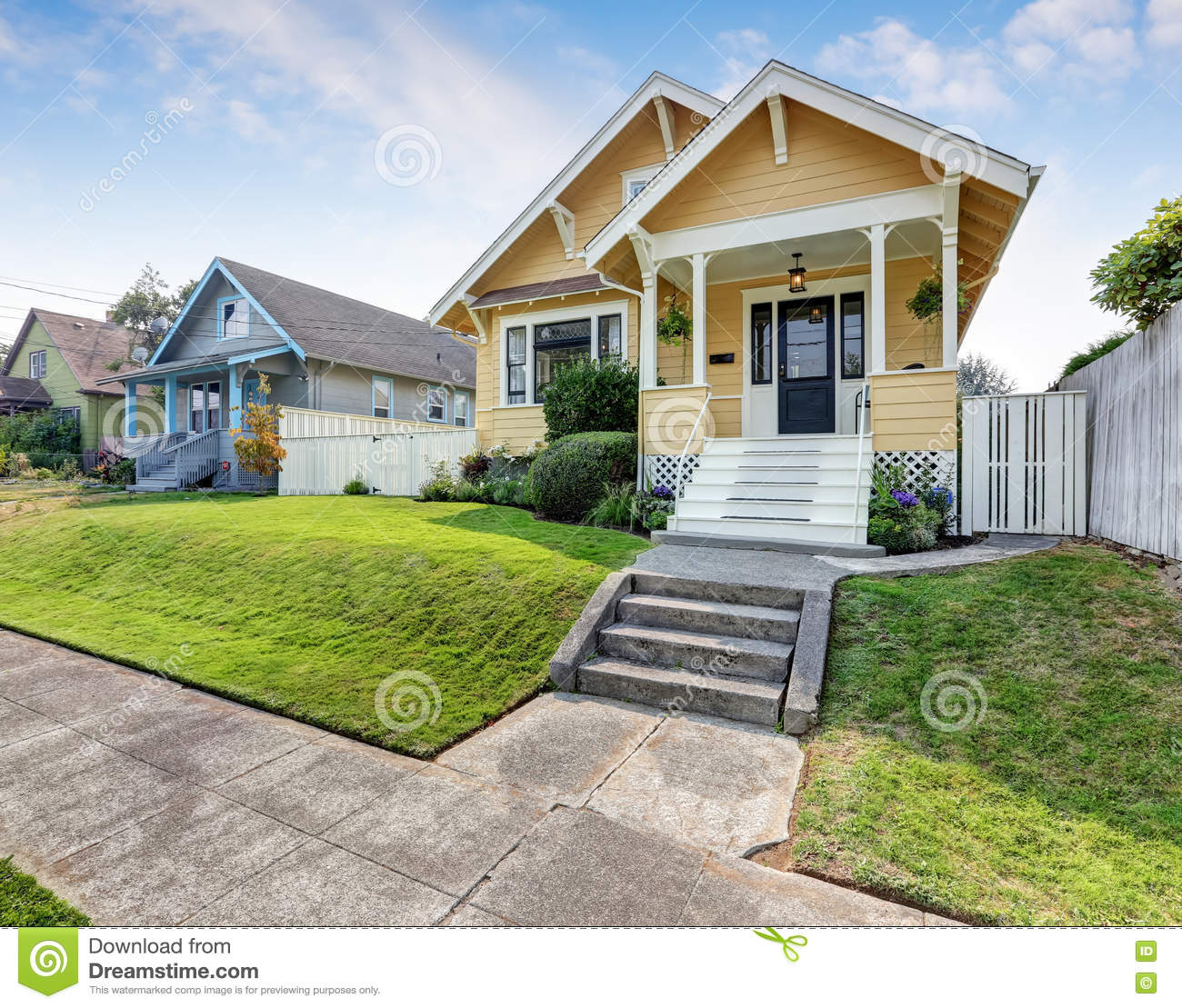 Front Porch Of Yellow House Stock Photo: Home Exterior With Classic Northwest Charm Royalty-Free