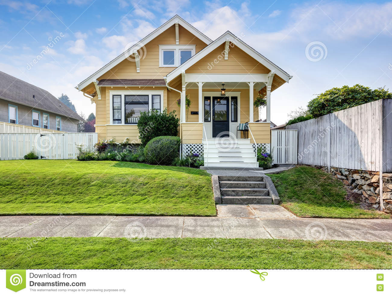 American craftsman home with yellow exterior paint stock image image 76504251 for Exterior paint yellow