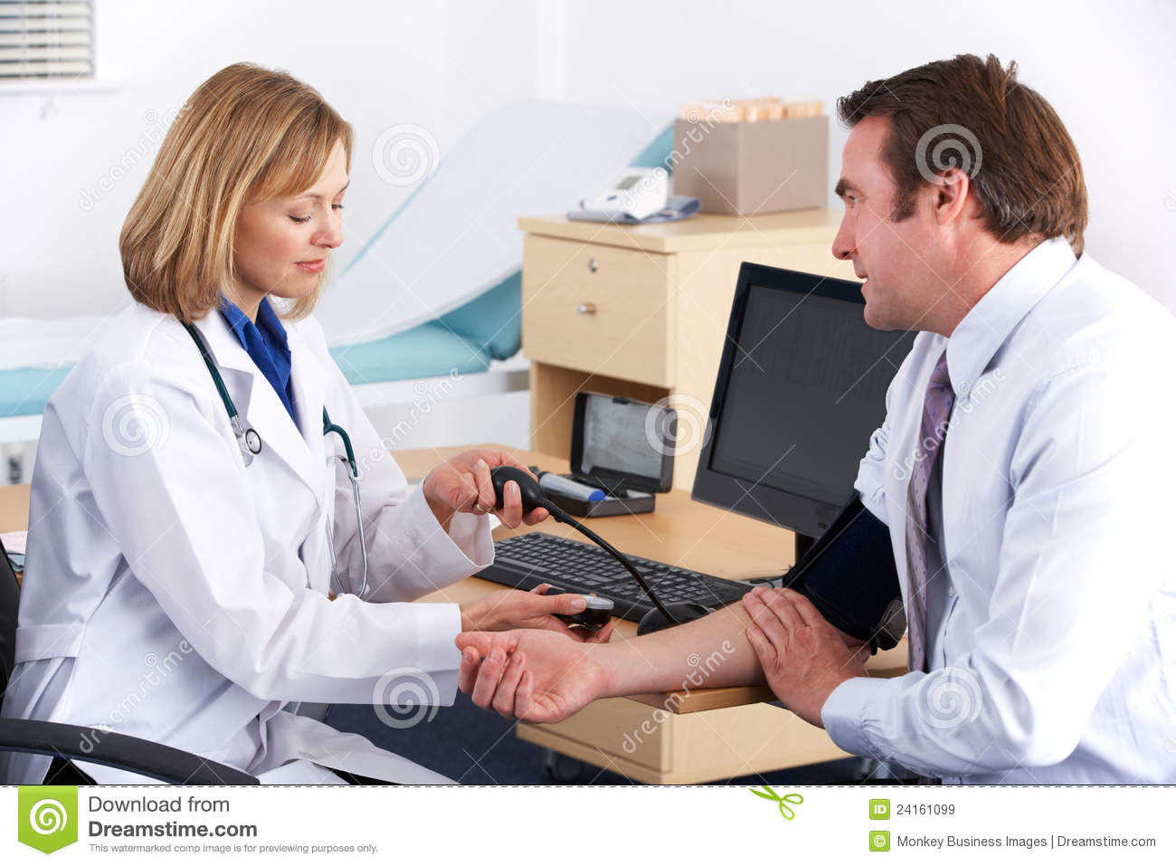 American Doctor Taking Patient's Blood Pressure Royalty ...
