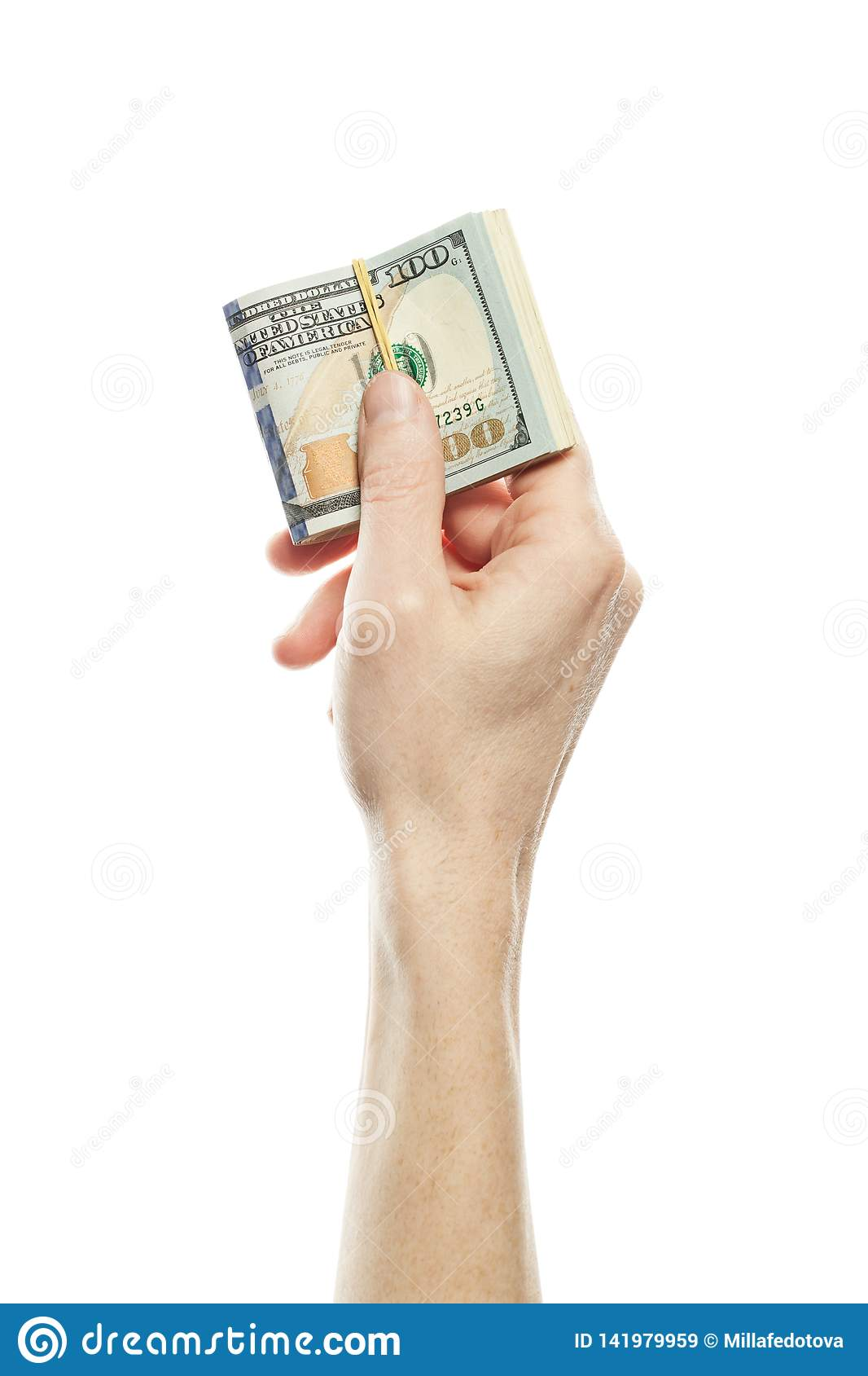 American dollars cash money in male hand isolated on white background. Many US Dollars 100 banknote