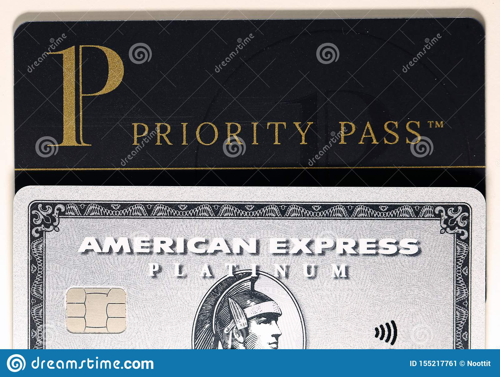 American Express Amex Platinum & Priority Pass Card On A White