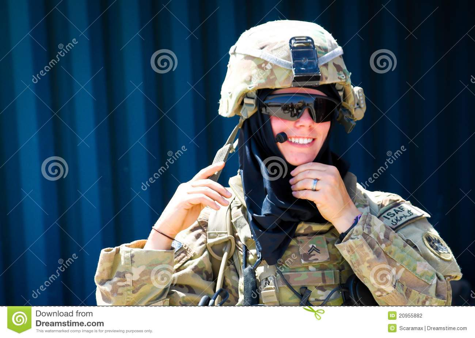 American female soldier in Afghanistan is preparing for meeting with ...
