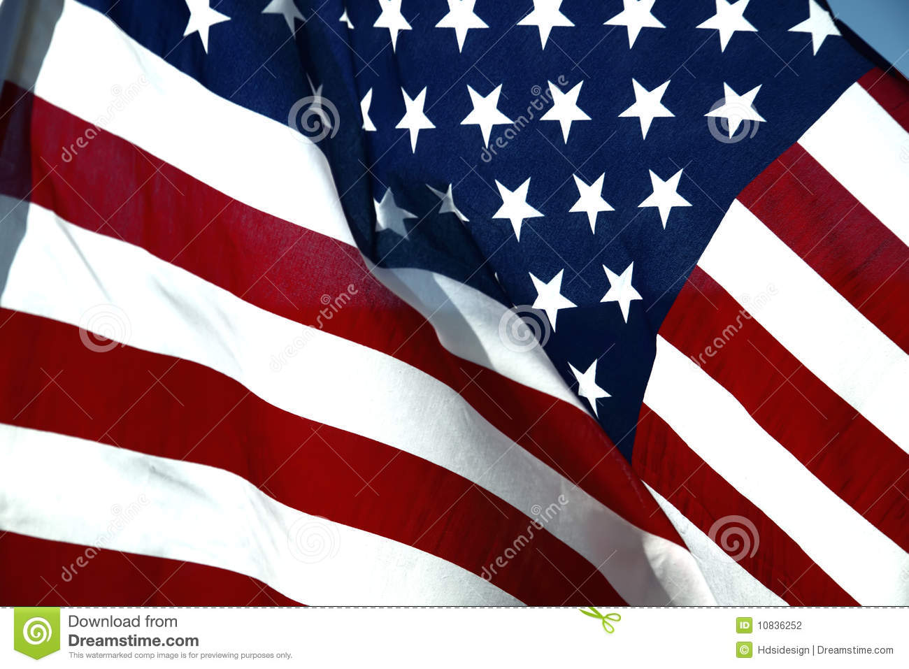 74ac7f0559dd Closeup of Stars and Stripes American flag blowing in wind.