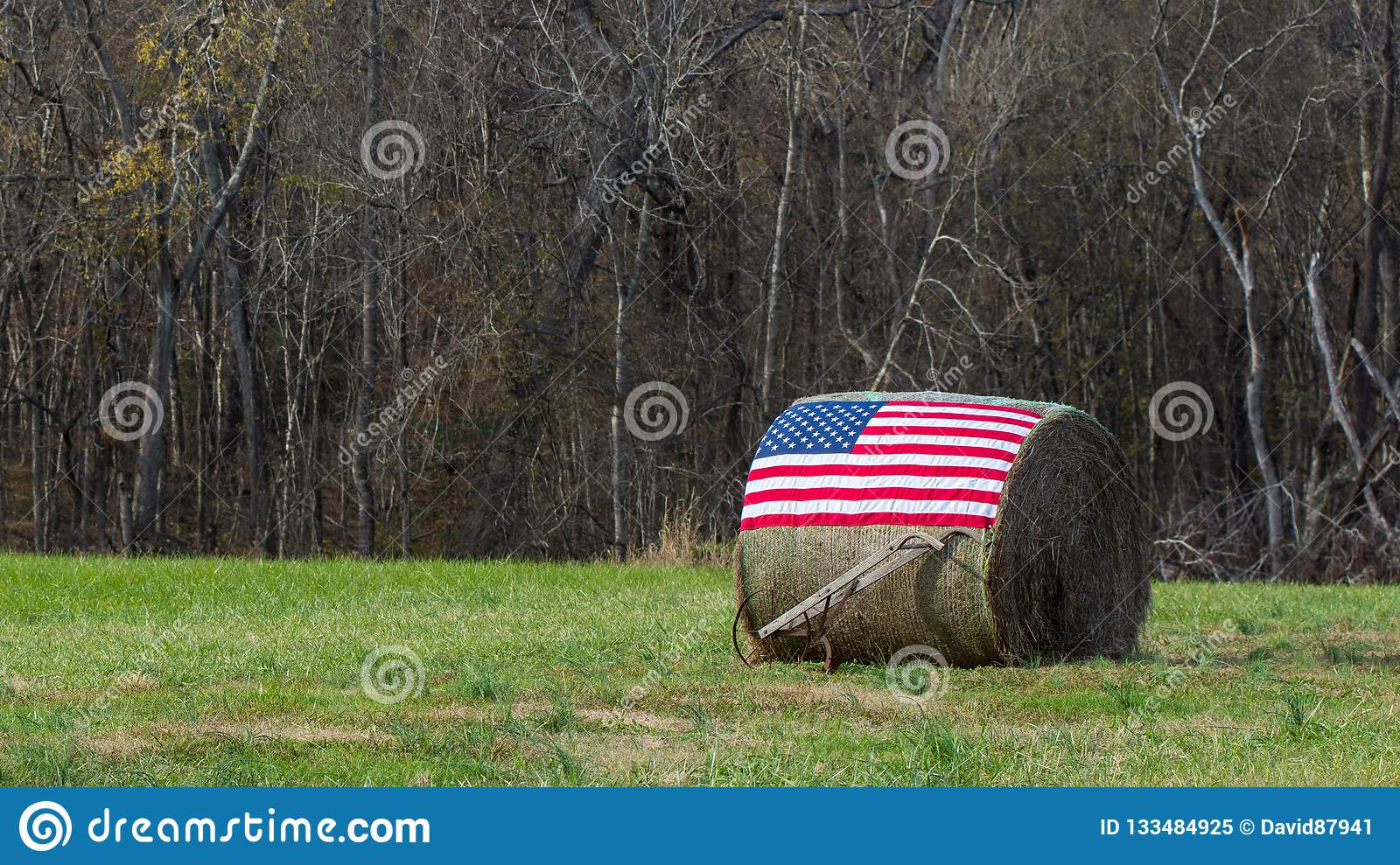American flag on bale of hay