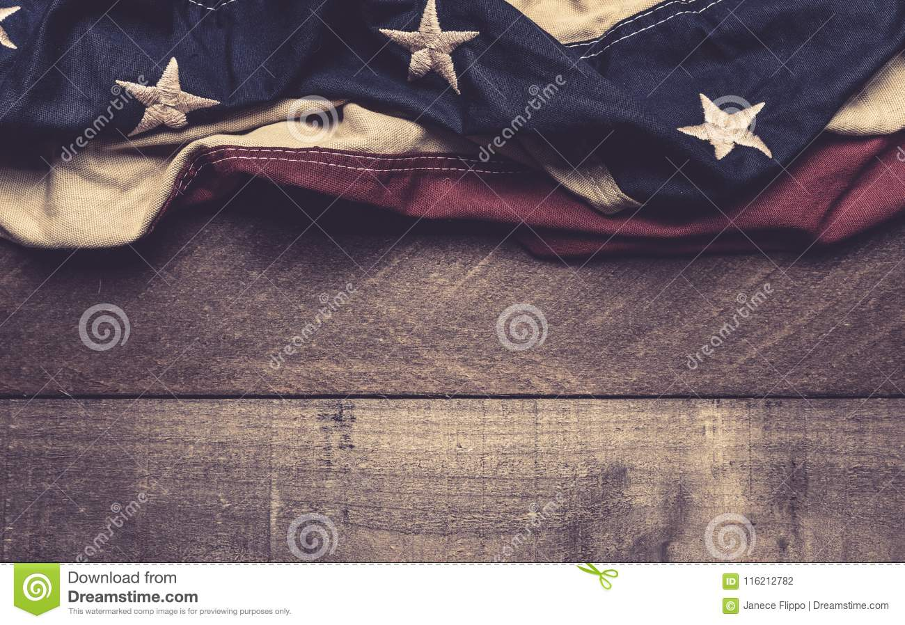 An American flag or bunting on a wooden background