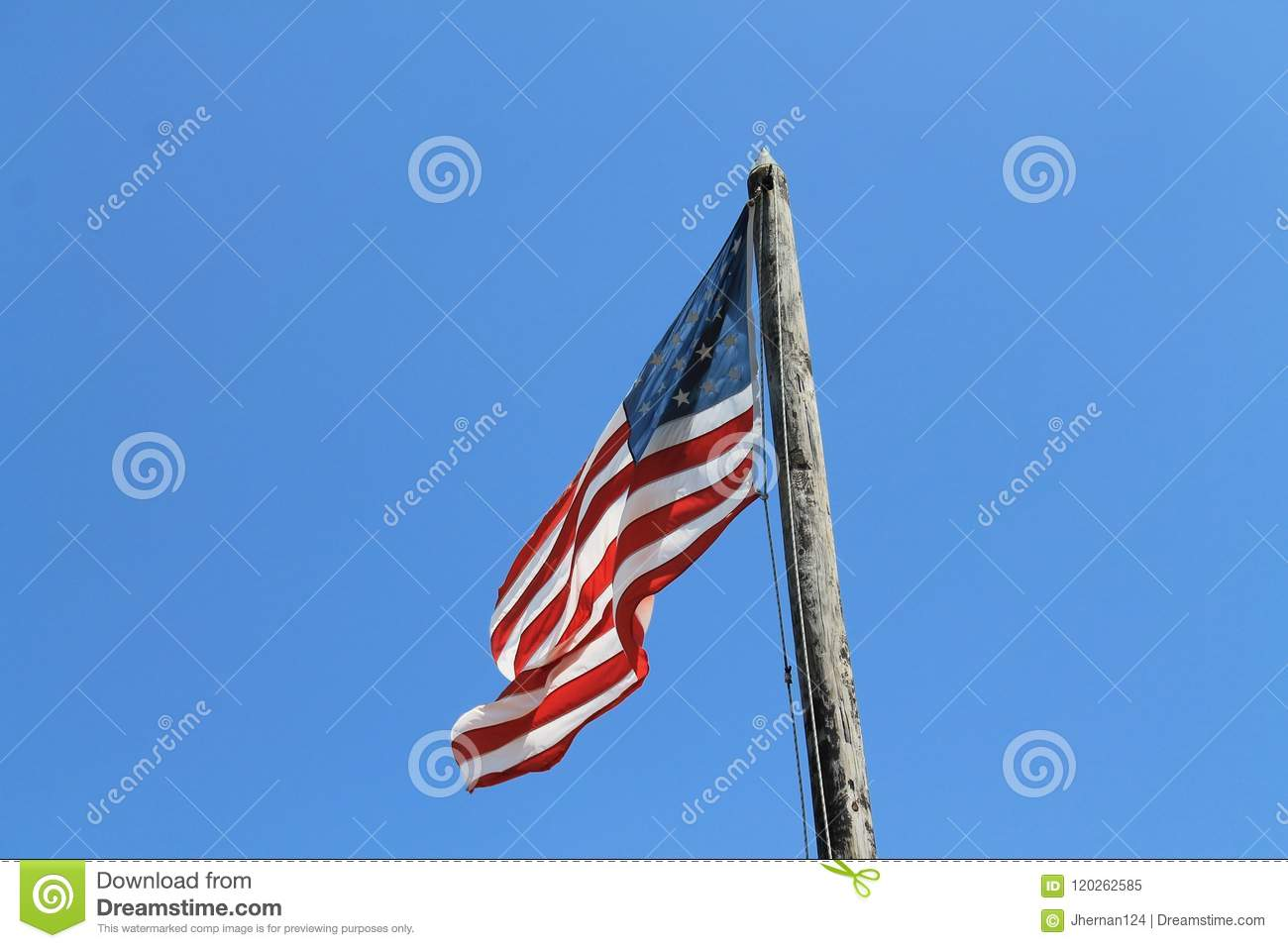 American Flag Flying From Old Pole Key West Stock Image