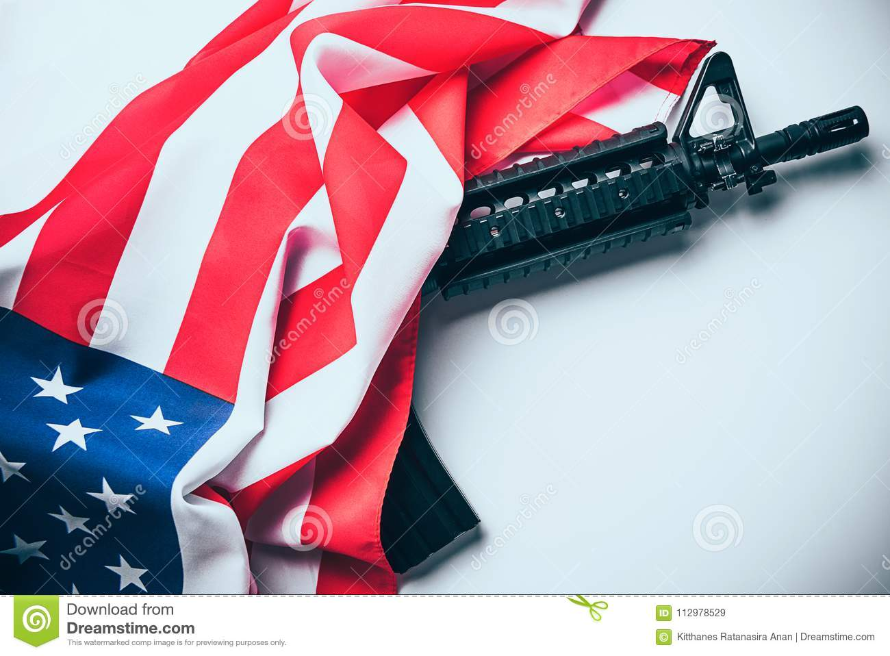 American flag with gun on white background