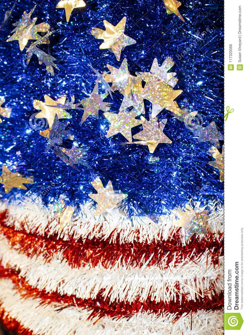 American Flag motif in red white and blue tinsel with sparkly stars with a bokeh blur effect - background or design element