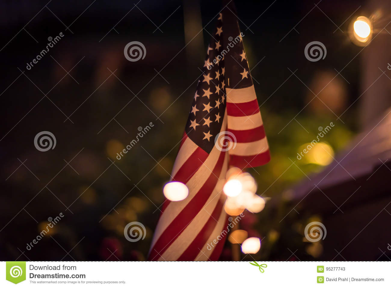 American flag at night with sparklers and bokeh lights