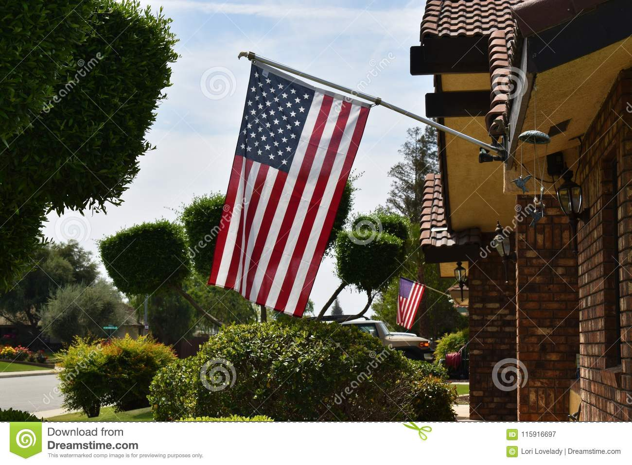 Patriotic American Flags Hanging From Neighboring Houses